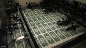 WASHINGTON, DC - MARCH 24: Sheets of one dollar bills run through the printing press at the Bureau of Engraving and Printing on March 24, 2015  in Washington, DC. The roots of The Bureau of Engraving and Printing can be traced back to 1862, when a single room was used in the basement of the main Treasury building before moving to its current location on 14th Street in 1864. The Washington printing facility has been responsible for printing all of the paper Federal Reserve notes up until 1991 when it shared the printing responsibilities with a new western facility that opened in Fort Worth, Texas.(Photo by Mark Wilson/Getty Images)