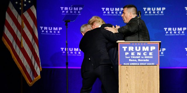 U.S. Republican presidential nominee Donald Trump is hustled off the stage by security agents after a perceived threat in the crowd, at a campaign rally in Reno, Nevada, U.S. November 5, 2016. REUTERS/Steven Styles