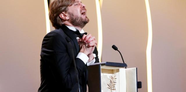 "70th Cannes Film Festival - Closing ceremony - Cannes, France. 28/05/2017.  Director Ruben Ostlund , Palme d'Or award winner for his film ""The Square"",  reacts.       REUTERS/Stephane Mahe"