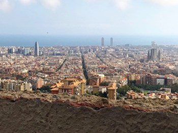 Barcelona, Spain – October 13, 2019: Barcelona panorama from Carmel Bunkers. Barcelona skyline with emblematic buildings as Agbar Tower and Sagrada Familia and the sea in the background.
