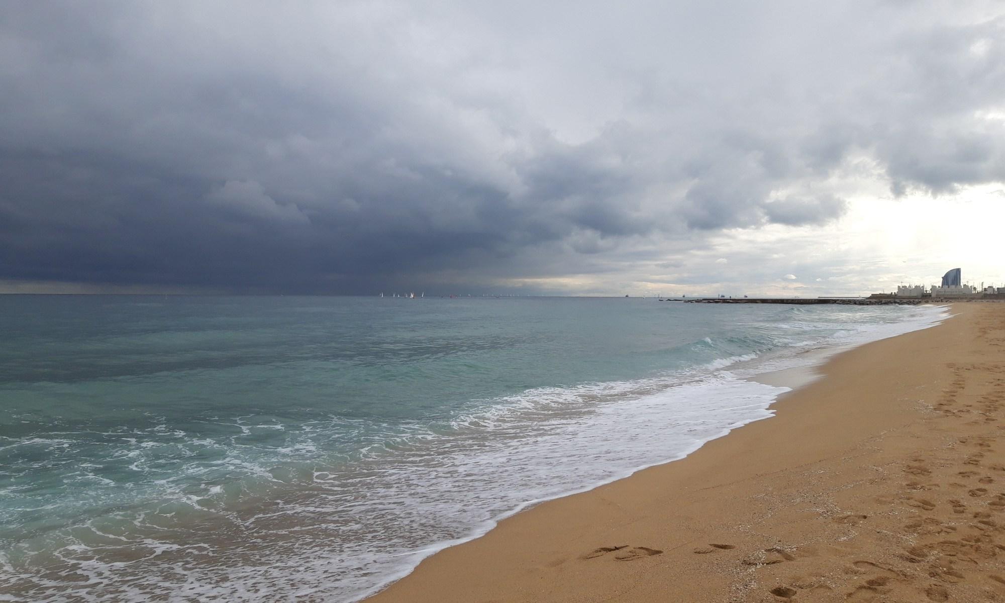 Barcelona, Spain – January 21, 2020: Empty Bogatell Beach. Sand and sea contrasting their colours.