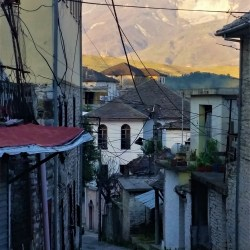 Gyrokaster, Albania – March 25, 2016: Old empty street at sunset in Gyrokaster, Albania.