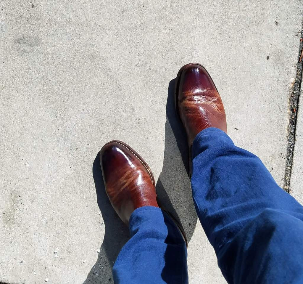 shined cole haan boots