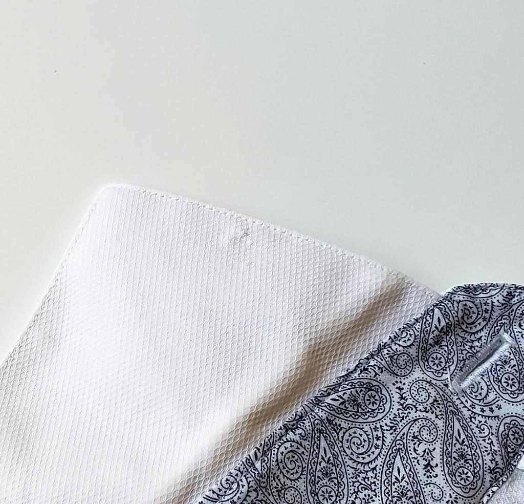damage to a shirt collar