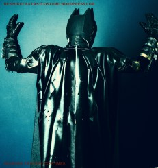 'The Bat's going to jump!' Back view of mask, cape, gloves, gauntlets made by Mr.Bespoke of Bespoke Fantasy Costumes. Batman TDK battle worn custom made look. Costume by Bespoke Fantasy Costumes. Photography and edit by Rose-Sky Journey Pieces. Copyright 2016.
