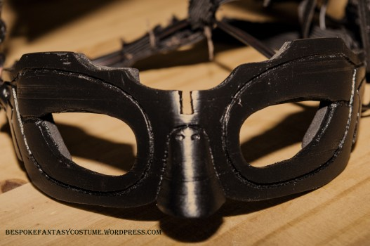 Catwoman mask, image two. Design altered, 3d printed and constructed by Bespoke Fantasy Costumes. Photography by Rose-Sky Journey Pieces. 2017.