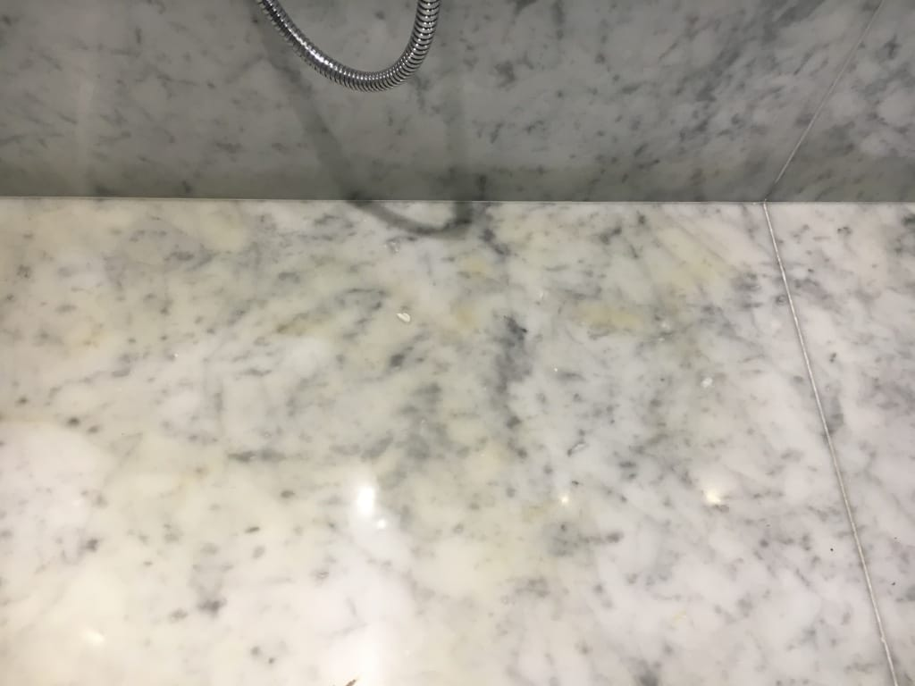 Marble shower stain removal  Bespoke Repairs