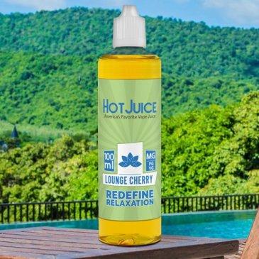 Hot Juice lounge-cherry-cbd-vape-juice bottle on pool deck against green hills