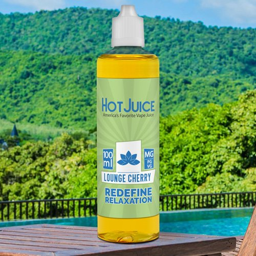 Hot Juice lounge-cherry-cbd-vape-juice bottle on pool deck against green hills