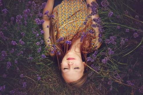 woman relaxing with lavender flowers