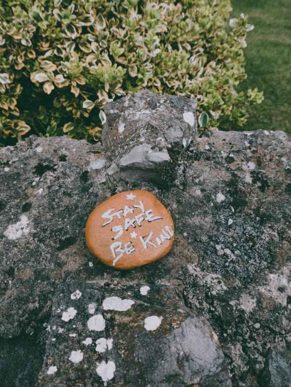 stay safe be kind inscription on stone