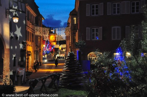 Illuminated street in Selestat. During the Christmas period (end of November to beginning of January), firs are everywhere in Selestat!