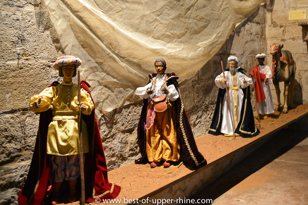 Nativity scene in the romanesque church of St Peter and Paul in Rosheim, Alsace. The Magi are on their way ...