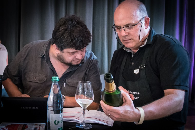 Yves Beck (left), famous wine-taster and journalist from Switzerland, is interested in the Crémants of Alsace presented to him by Bernd Koppenhoefer of the Domaine Jean-Paul Schmitt during the wine and gastronomy festival of Ribeauvillé.