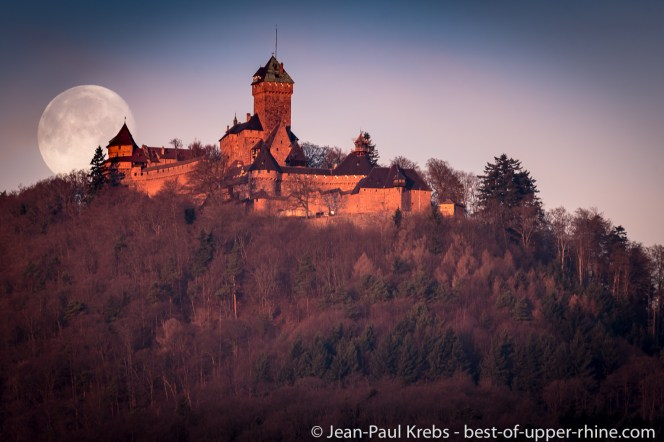 Sunrise and moon set on the Haut-Koenigsbourg castle.
