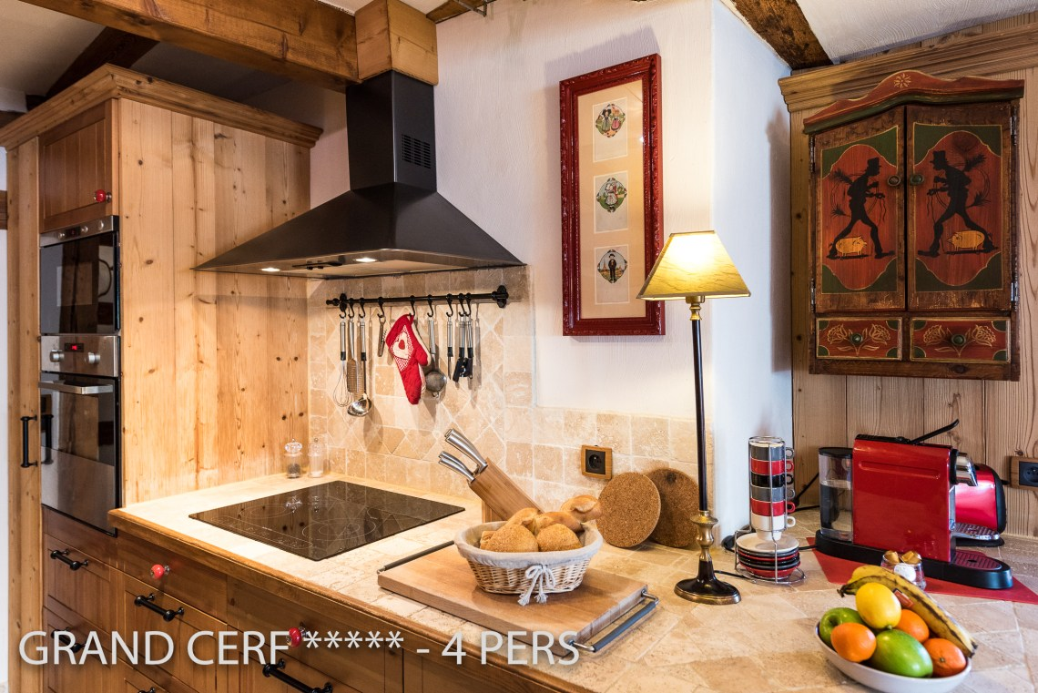 The kitchen of the Alsatian Hart, Outstanding Luxury Gite in Riquewihr, have a real oven, microwaves, and Nespresso