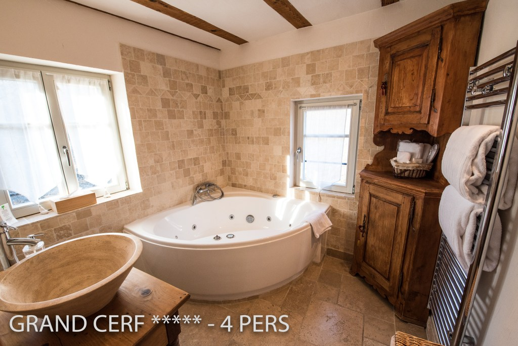 One bathroom of the Alsatian Hart, Outstanding Luxury Gite in Riquewihr, have a corner bath