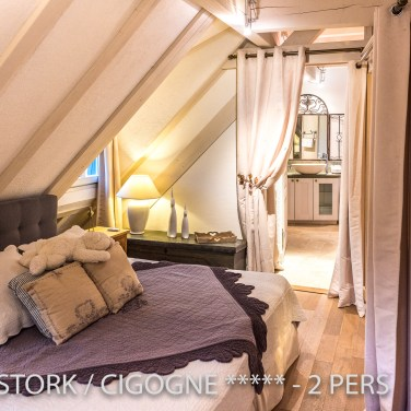 The bedroom with en suite bathroom of the White Stork, spectacular and romantic loft apartment with terrace in Riquewihr in Alsace on the Alsace Wine Route!