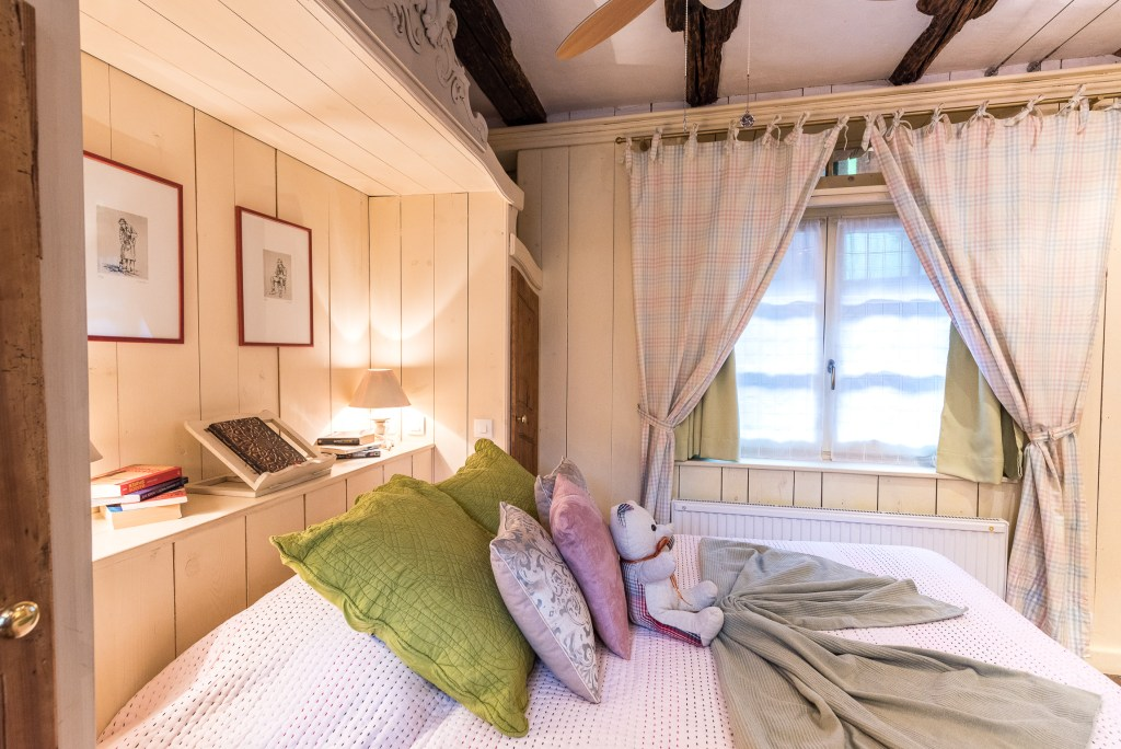 The Bed of the The Gobelin's romantic Studio, charming studio with great comfort and Large double bed in Riquewihr for 2 persons