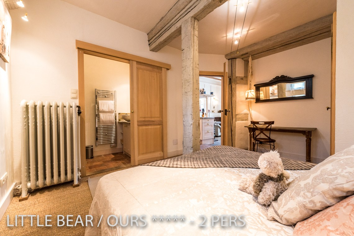 The bedroom with ensuite bathroom of the Little Bear, romantic and charming apartment for 2 adults in Riquewihr in Alsace