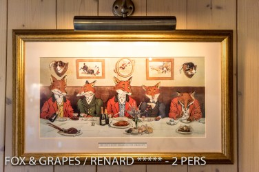 The fox painting in living room of the Fox & Grapes, romantic and charming apartment for 2 adults is located in the medieval heart of Riquewihr in Alsace