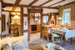 The main room and kitchen of the Fox & Grapes, romantic and charming apartment for 2 adults is located in the medieval heart of Riquewihr in Alsace