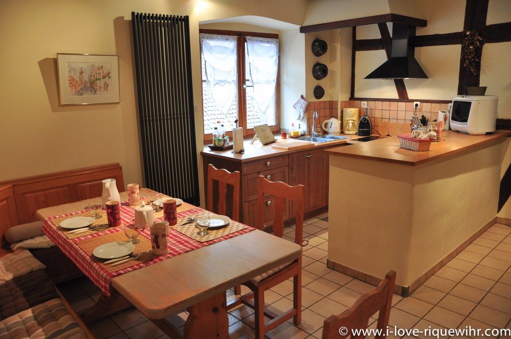 The dining room and the kitchen of Riesling, beautiful and charming apartment for 2-4 adults is located in the medieval heart of Riquewihr in Riquewihr Alsace