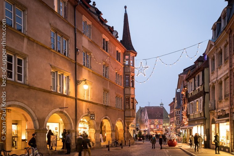 Colmar romantic city at Christmas time. On the way to the Koïfhus, the old medieval building of customs..