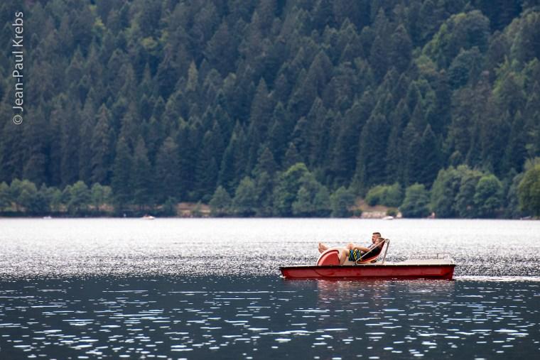 Peaceful pedalo sailing on Lake Longemer.
