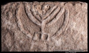 1513704379942 - Ancient tomb door with stunning menorah carving revealed in Israel