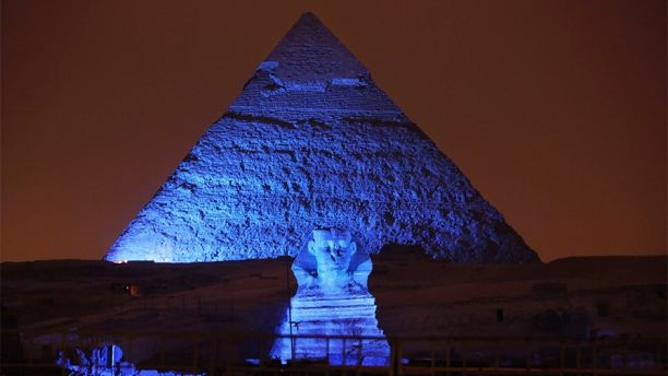 FILE - In this Saturday, Oct. 24, 2015, file photo, the Sphinx and the historical site of the Giza Pyramids are illuminated with blue light, as part of the celebration of the 70th anniversary of the United Nations in Giza, just outside Cairo, Egypt. Archaeologists in Egypt say they have discovered a 4,400-year-old tomb near the pyramids outside Cairo. Egypt's Antiquities Ministry announced the discovery Saturday and said the tomb likely belonged to a high-ranking official known as Hetpet during the 5th Dynasty of ancient Egypt. (AP Photo/Amr Nabil, File)