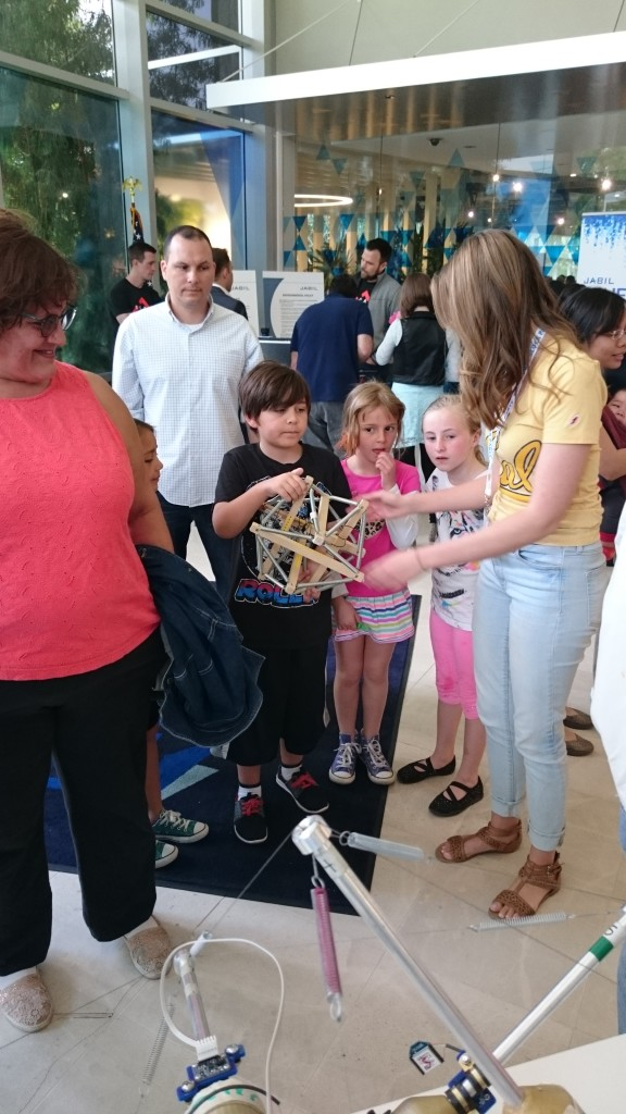 "BEST Labber Mallory Daly explains ""tensegrity"" to a group of children at the 2016 Robot Block Party"