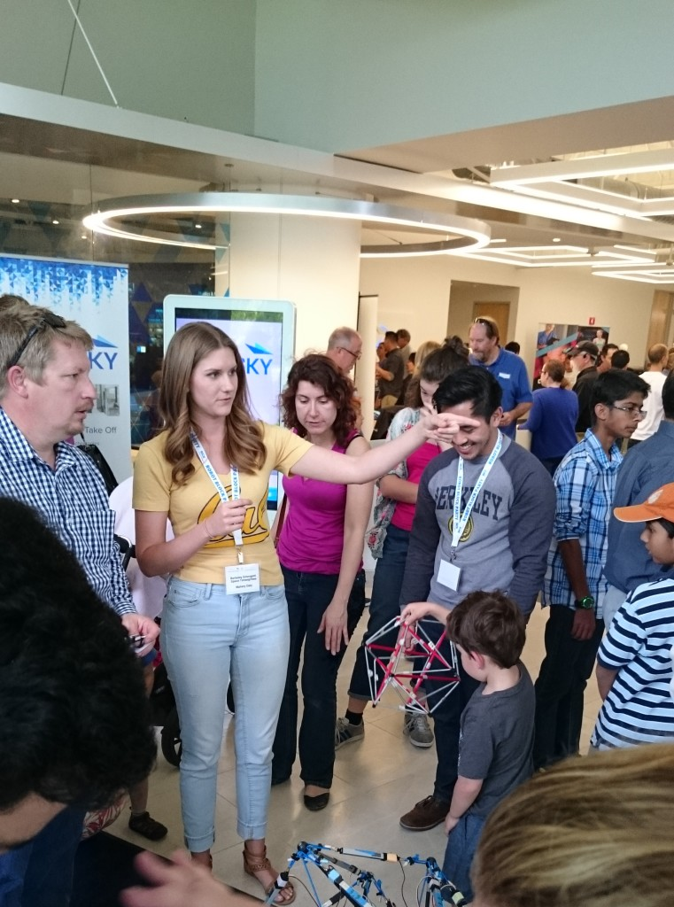 BEST Labbers Mallory Daly and Brian Cera show tensegrity models to young future engineers at the 2016 Robot Block Party!