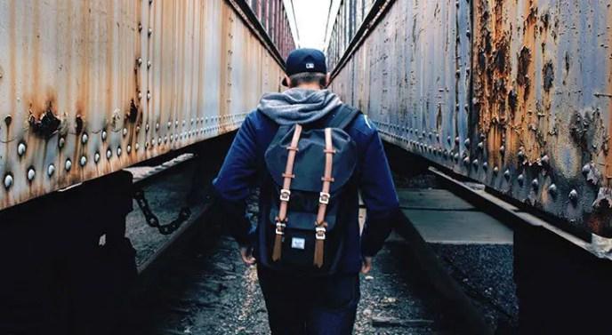 man wearing a herschel backpack