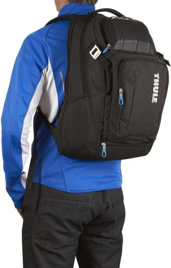 man wearing a thule crossover 32l backpack