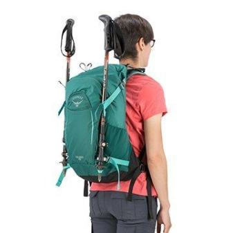 osprey backpack with trekking poles attached