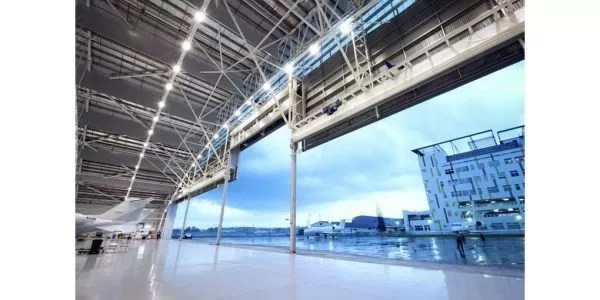 Multiple-leaf aviation hangar door systems