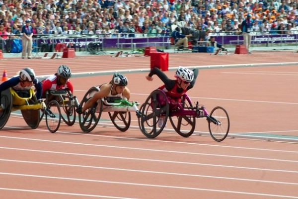 3 participants on the racing track as part of the paralympic games