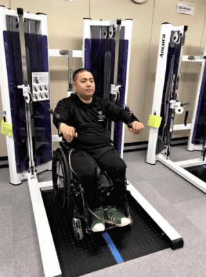 person in a wheelchair in a gym