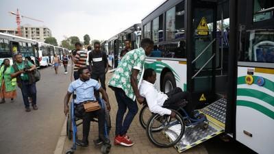 Persons in wheelchairs boarding a bus in Rwanda