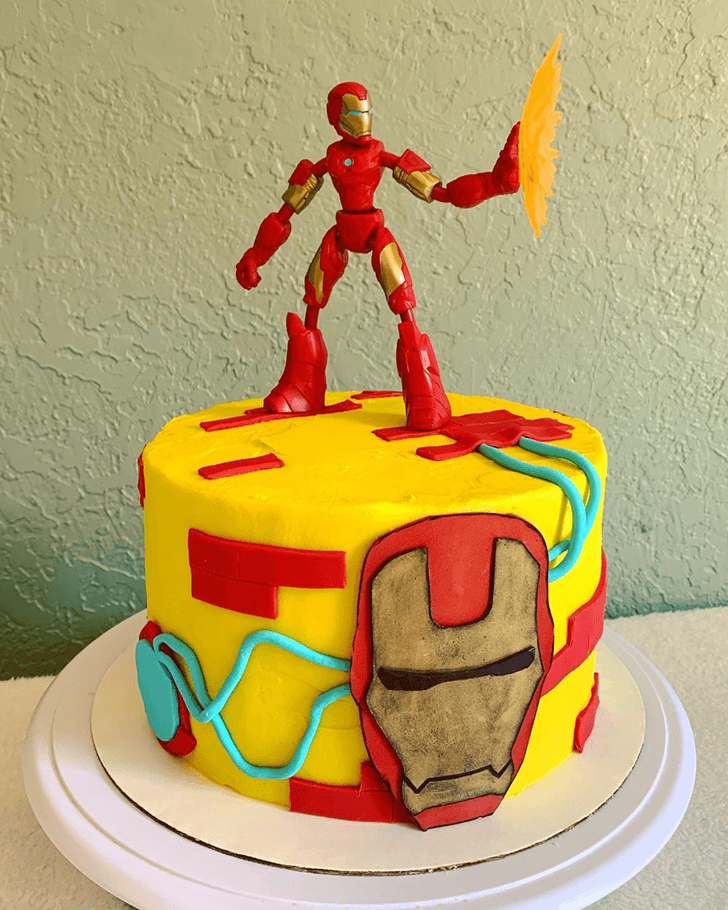 Iron Man Cake with Iron Man Toy on Top and Red Yellow Blue Base