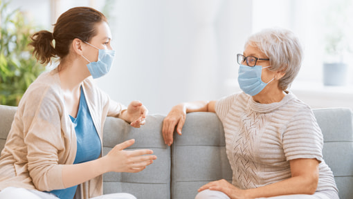 care working and patient wearing face masks