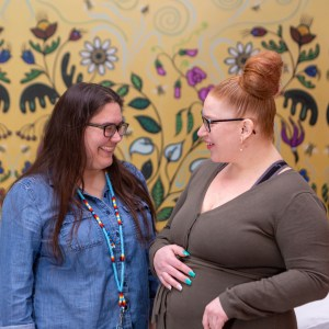 Alicia Lariviere (right) shares a laugh with a Unity Health Toronto staff member.