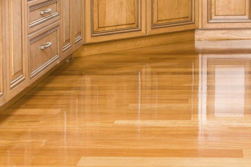 Applied glossy oil based polyurethane finish in hardwood floor
