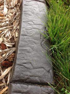 Dark charcoal base, black release, stone stamp