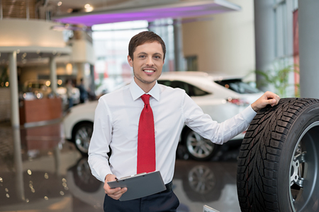 53679430 - young salesman with rubber in service