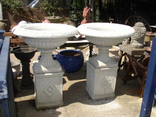 Large Grecian Urns on Diamond Plinths