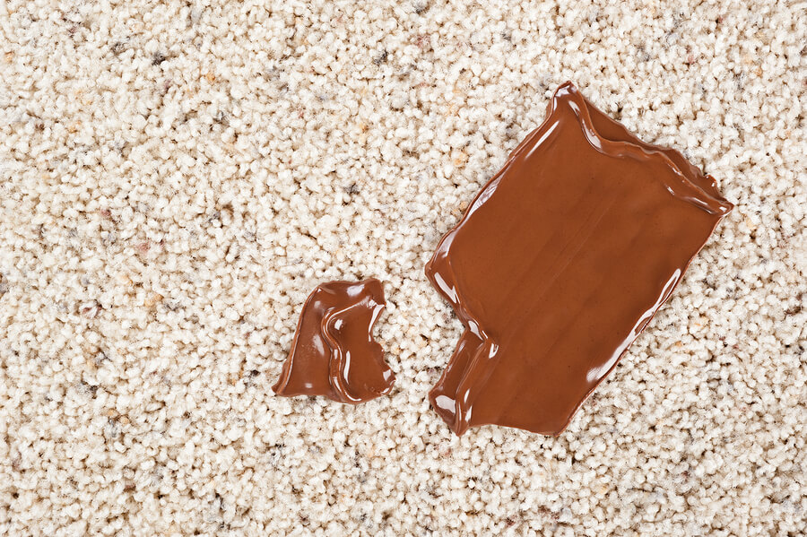 A melting chocolate candy bar dropped on a newly carpeted floor