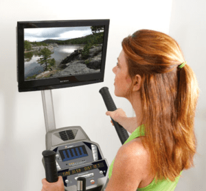 woman watching tv while on elliptical