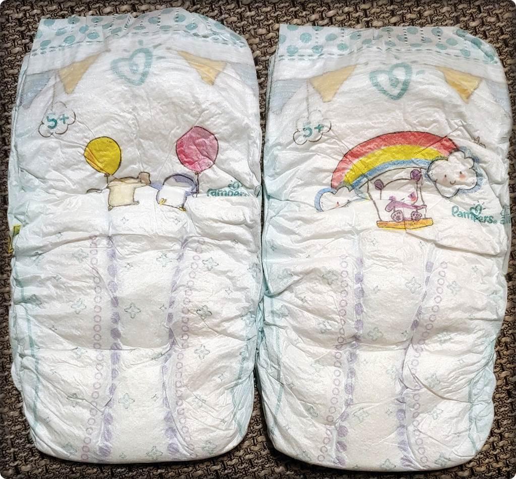 2 einzelne Pampers baby-dry Größe 5+ Vorderseite